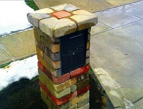 A multicolored high end mailbox with a cap on top