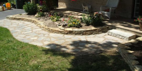 Jonathan Allen – Flagstone pic – Flag stone walkway with a natural stone wall and a single limestone step