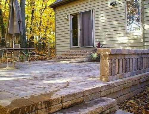 Paver patio with a standing seating wall